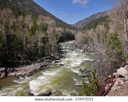 Animas River running between a Wooded Valley in the heart of the Colorado Rocky Mountains in the USA - stock photo