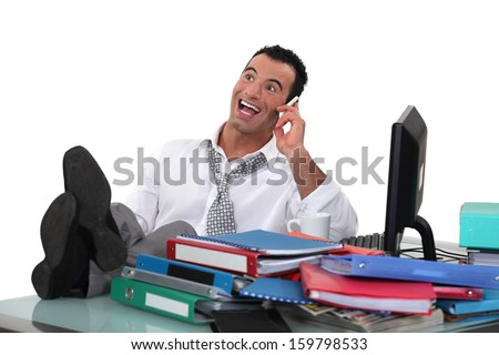 Animated businessman at his desk - stock photo