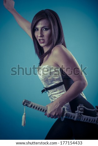 Anime stylized brunette with short hair holding a katana sword with two hands - stock photo