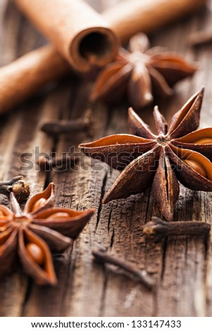 anise and cloves on wooden background - stock photo