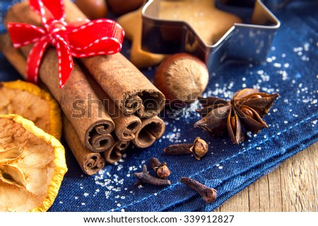 Anise, cinnamon, dried fruits and nuts - Christmas spices for cookies or mulled wine - stock photo