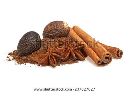 Anise, cinnamon sticks and nutmeg on a white background - stock photo