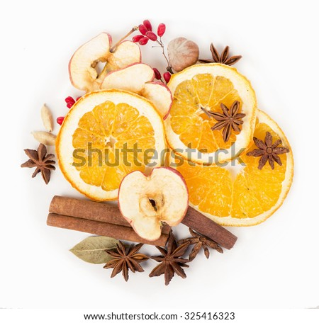 Anise star, Cinnamon stick and fresh orange, Christmas spices for hot mulled wine isolated on white background, closeup - stock photo