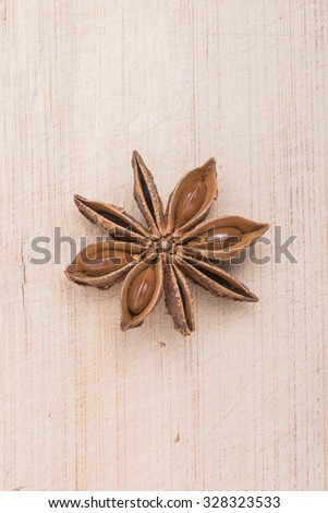 Anise star on white wooden background - stock photo