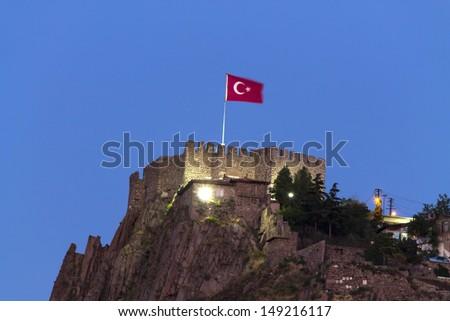 Ankara castle with Turkish flag at night, Ankara, Turkey. - stock photo
