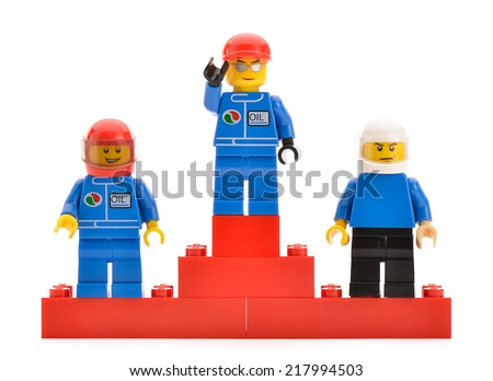 Ankara, Turkey - April 09, 2013:  Three top placed Lego minifigure drivers in a race stand on a podium for the trophy ceremony.   - stock photo