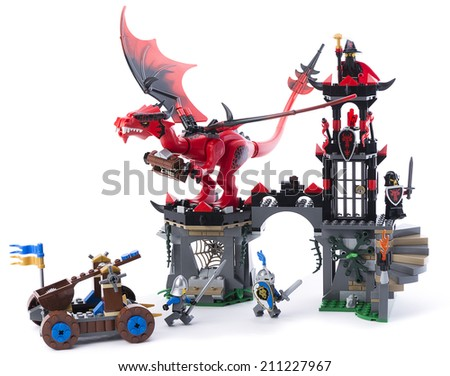 Ankara, Turkey - February 15, 2014 : Studio shot of Lego Castle with prison tower and minifigures including princess and knights isolated on white background.  - stock photo