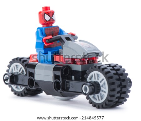 Ankara, Turkey - January 24, 2014: Lego Marvel super hero spiderman on his motorcycle isolated on white background - stock photo