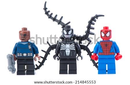Ankara, Turkey - January 24, 2014: Lego Marvel super heroes including spiderman, venom and Nick Fury isolated on white background. - stock photo