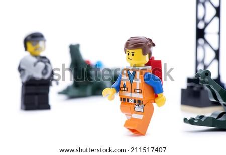 Ankara, Turkey - March 15, 2014 : Studio shot of Lego Movie bad cop trying to catch Emmet isolated on white background.  - stock photo
