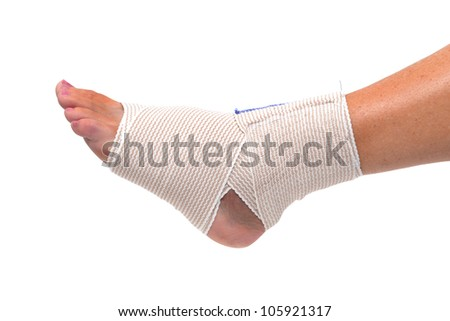 ankle and foot wrapped in bandage - stock photo