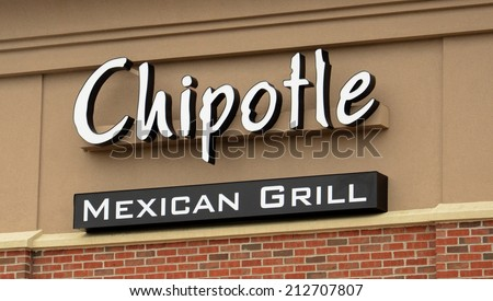 ANN ARBOR, MI - AUGUST 24: Chipotle Mexican Grill store logo in Ann Arbor on August 24, 2014. Chipotle has 1680 stores in the United States and leads the industry in loyal customer following.  - stock photo