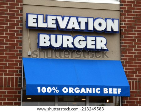 ANN ARBOR, MI - AUGUST 24: Elevation Burger, whose east Ann Arbor store front is shown on August 24, 2014, is the first and largest organic burger chain in the country. - stock photo