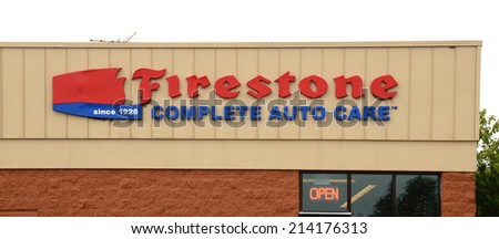 ANN ARBOR, MI - AUGUST 24: Firestone, whose east Ann Arbor store logo is shown on August 24, 2014, has over 1,600 auto care store locations.  - stock photo