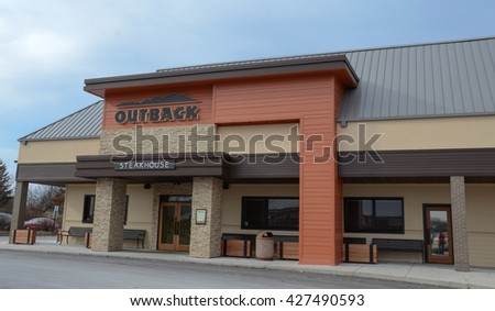ANN ARBOR, MI - JANUARY 30: Outback Steakhouse, whose south Ann Arbor, MI store is shown January 30, 2016, has over 700 locations. - stock photo