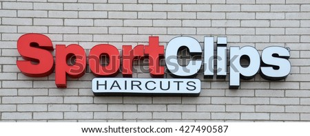 ANN ARBOR, MI - JANUARY 30: Sport Clips, whose south Ann Arbor, MI store logo is shown January 30, 2016, opened its 1,500th location in April 2016.  - stock photo