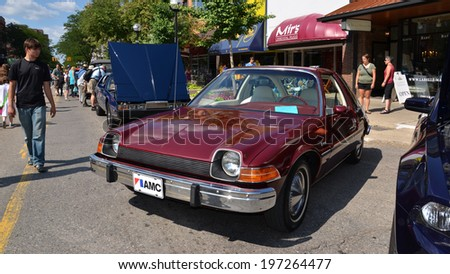ANN ARBOR, MI - JULY 12: 1975 AMC Pacer  at the Rolling Sculpture car show  July 12, 2013 in Ann Arbor, MI - stock photo