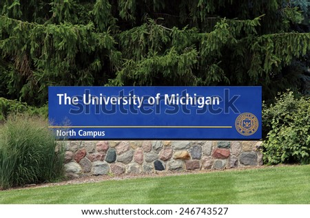 ANN ARBOR, MI - JULY 30: An entrance to The University of Michigan located in Ann Arbor, Michigan on July 30, 2014. The University of Michigan is a public research university established in 1817. - stock photo