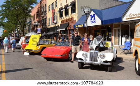ANN ARBOR, MI - JULY 13: 1955 MG, 1994 Corvette, and 1970 Ferrari at the Rolling Sculpture car show July 13, 2012 in Ann Arbor, MI. - stock photo