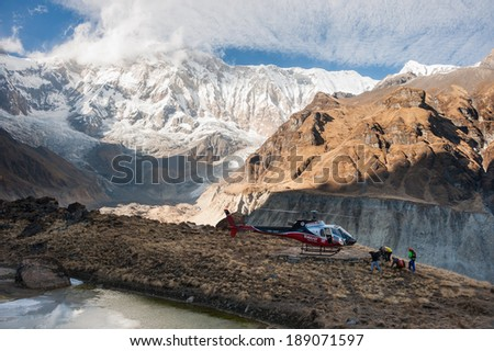 Annapurna Base Camp, Nepal - Nov 29:Rescue helicopter landing to evacuate mountain climbers after accident from Annapurna Base Camp, Nepal on November 29, 2013. - stock photo