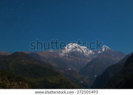 Annapurna I Himalaya Mountains in Nepal at night - stock photo