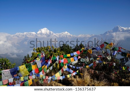 Annapurna mountain view from Poon Hill Peak with praying flags. - stock photo