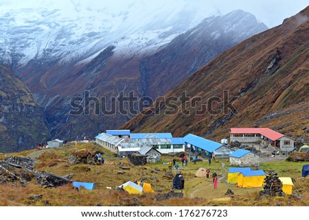 ANNAPURNA - OCT 3: Annapurna climbing expeditions forced to stay in the ABC, without any possibilities to reach the summit, due to bad weather. On Oct 3, 2013 in Annapurna Base Camp, Himalayas, Nepal  - stock photo