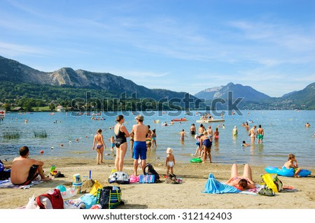ANNECY LAKE, FRANCE - AUGUST 27, 2015: People relax on the ...