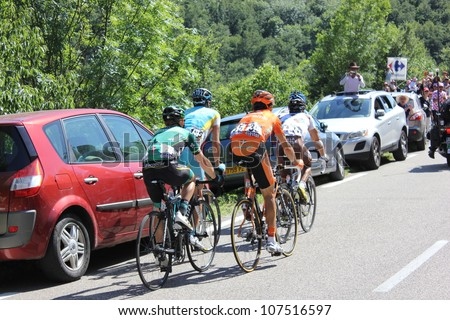 ANNONAY, FRANCE - JUL 13: J.C. Peraud, E. Martinez, C. Gauthier, R. Kiserlovski, D. Millar in stage 12 of Le Tour de France 2012. David Millar wins the race on July 13, 2012 in Annonay Ardeche, France - stock photo