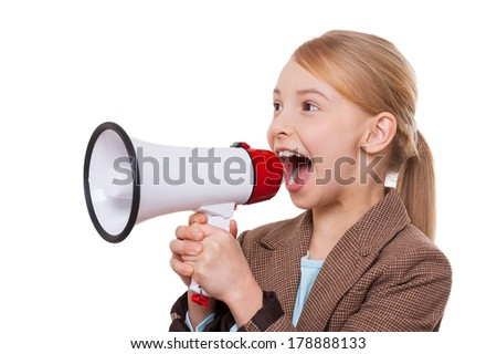 Announcing good news. Cheerful little girl in formalwear shouting at megaphone while standing isolated on white - stock photo