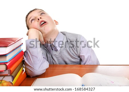 Annoyed Kid on the School Desk on the white background - stock photo