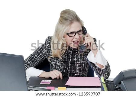 Annoyed secretary talking through the telephone - stock photo