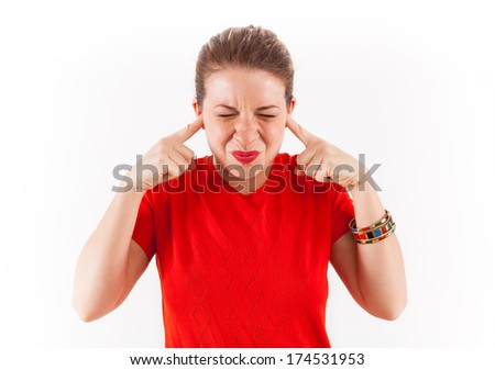 Annoyed Woman With Fingers Plugging Ears, on white background. - stock photo
