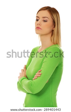 Annoyed young woman with arms crossed. - stock photo