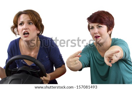 "annoying female passenger by being a ""backseat driver"" - stock photo"