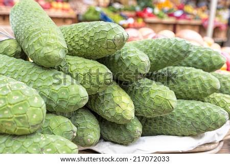 Anona fruits on display on a market - stock photo