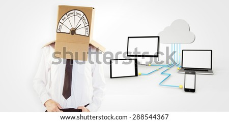 Anonymous businessman with hands in waistband against media appliances connecting through cloud computing - stock photo