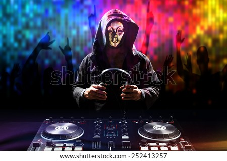 Anonymous disc jockey mixes the track turntable to play music and crowd in nightclub at party - stock photo