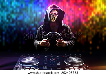 Anonymous disc jockey mixes the track turntable to play music in nightclub at party - stock photo