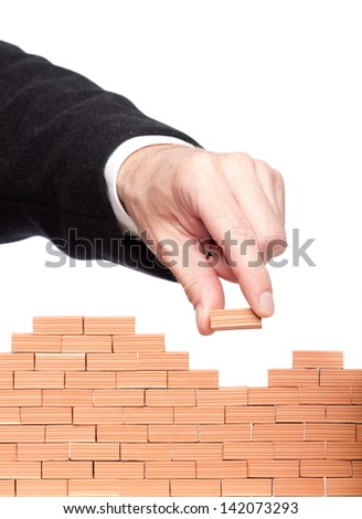 another brick in the wall isolated on white background - stock photo