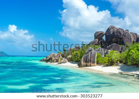 Anse Source d'Argent - granite rocks at beautiful beach on tropical island La Digue in Seychelles - stock photo