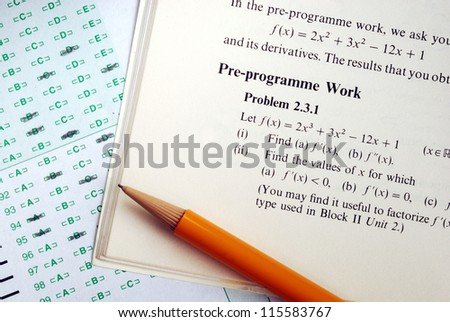 Answer a complicated mathematics question in an exam or test - stock photo