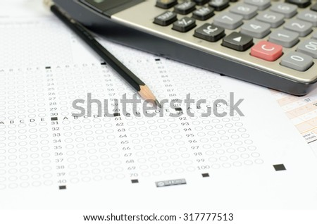 Answer Sheet with and pencil - stock photo