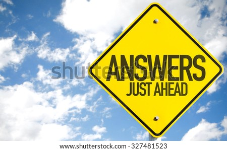 Answers Just Ahead sign with sky background - stock photo