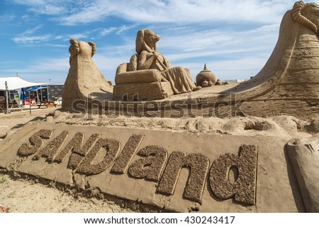ANTALYA, TURKEY - APRIL 23, 2016 : View of big sand sculptures made in Lara Beach, Antalya for sandland project, on cloudy blue sky background. - stock photo