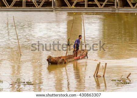 ANTANANARIVO, MADAGASCAR - JUNE 28, 2011: Unidentified Madagascar man in a boat in a river. People in Madagascar suffer of poverty due to the slow development of the country - stock photo