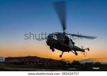 ANTANANARIVO, MADAGASCAR - OCT 2: An helicopter landing at sunset to the heliport of Antananarivo, Madagascar on oct. 2, 2007. - stock photo