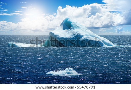 Antarctic ice island with penguins  in atlantic ocean - stock photo