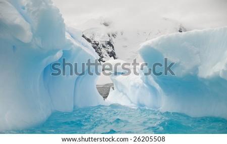 Antarctic iceberg cave - stock photo