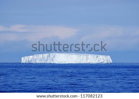 Antarctic iceberg in the ocean - stock photo